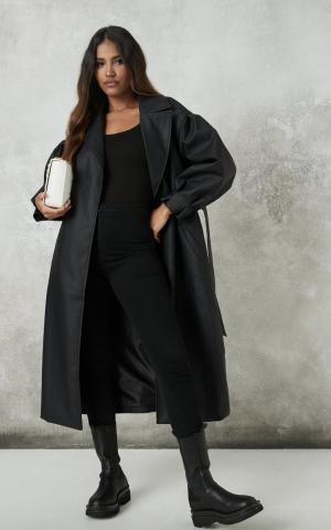 MissGuided trench-coat en similicuir noir à manches ballon avec ceinture grande taille